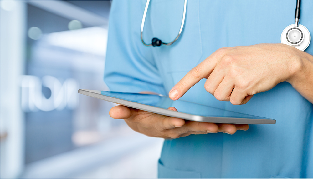 doctor using tablet technology